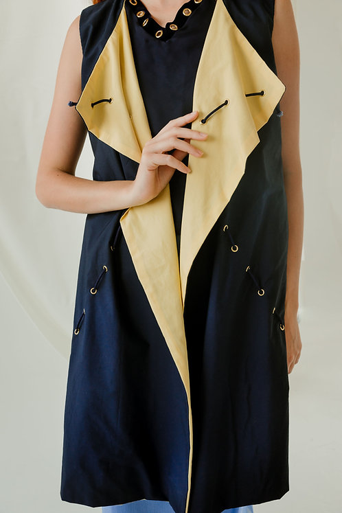 Close up of navy and yellow Regina Vest with the front lapels facing outward.