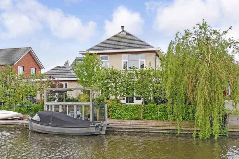 Vasgoedfotografie woning aan het water in Friesland