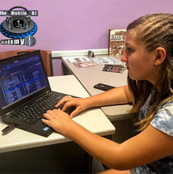 DJ Angelina _ange_miku working hard on her sister's graduation 🎓🎧🎶playlist for this weekend's party! _Her mother _danni401 says my daughter_
