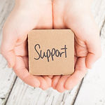 Support, Supportive hands on wood backgr