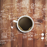 coffee cup and business strategy on wood