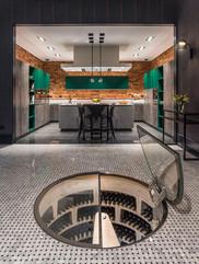 Spiral wine cellar in kitchen showroom