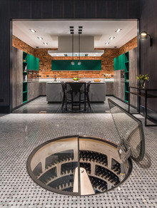 Spiral wine cellar in kitchen showroom