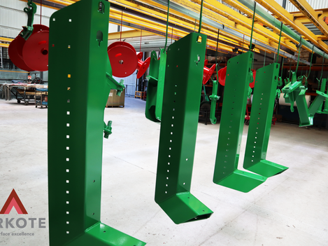 Agriculture machinery components top coated with Tuffkote by Arkote coating system.