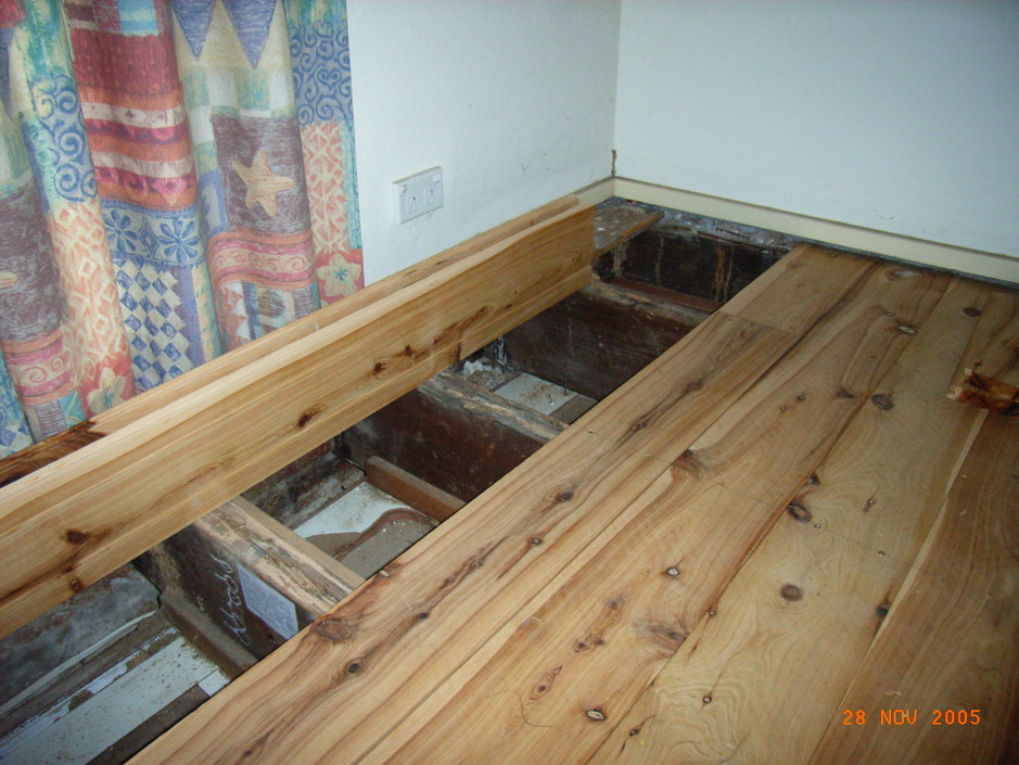 Removable floor boards to access joists