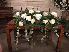 Registrar table flowers for Natasha and