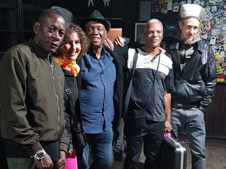 with the backing band at Brixton, UK
