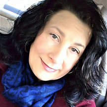 Kristina Hallett an attractive 50 year old white woman with blue eyes and black hair wearing a deep blue scarf around her neck