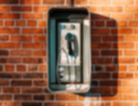 payphone-on-brick-wall.jpg