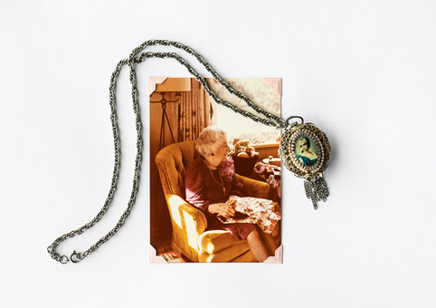 """Zita always said she was named after a European Empress.  A family member remembers, """"She was regal in her posture (bearing).  I never experienced her tearing into anyone, but somehow she wasn't one to be pushed around."""".   Necklace with a photo of Zita wearing it.  1970s"""