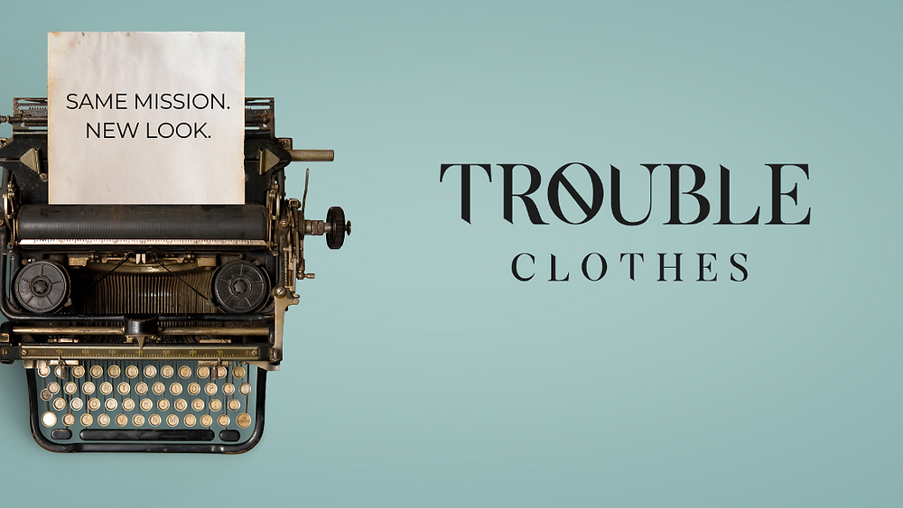 vintage type writer, teal background, Trouble Clothes logo