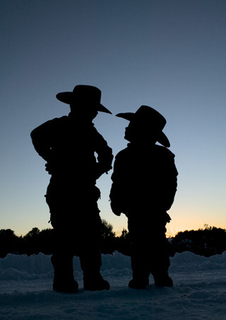 Young cowboys silhouetted