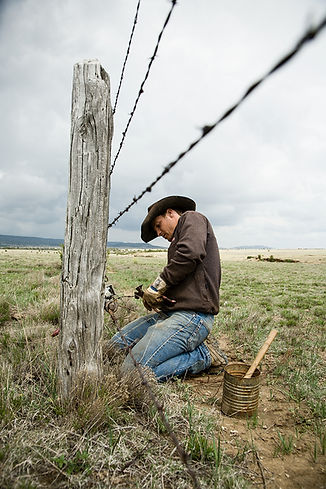 Richard working on the fence - Piñon Canyon