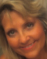 A face shot oAttorney Deborah M. Halisky, close up, and in an oval cropped frame.