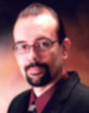A face shot f Attorney Jimmy Allen Davis in an oval cropped frame