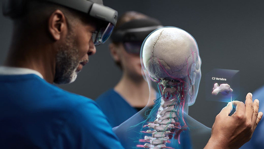 Healthcare worker wearing HoloLens 2 headset looks at hologram of the C3 vertebra