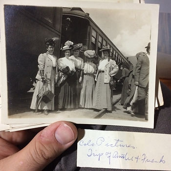 Turn of the century ladies about to take a railroad adventure