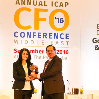 Rania Ali receives an Award of Excellence at the CFO Conference