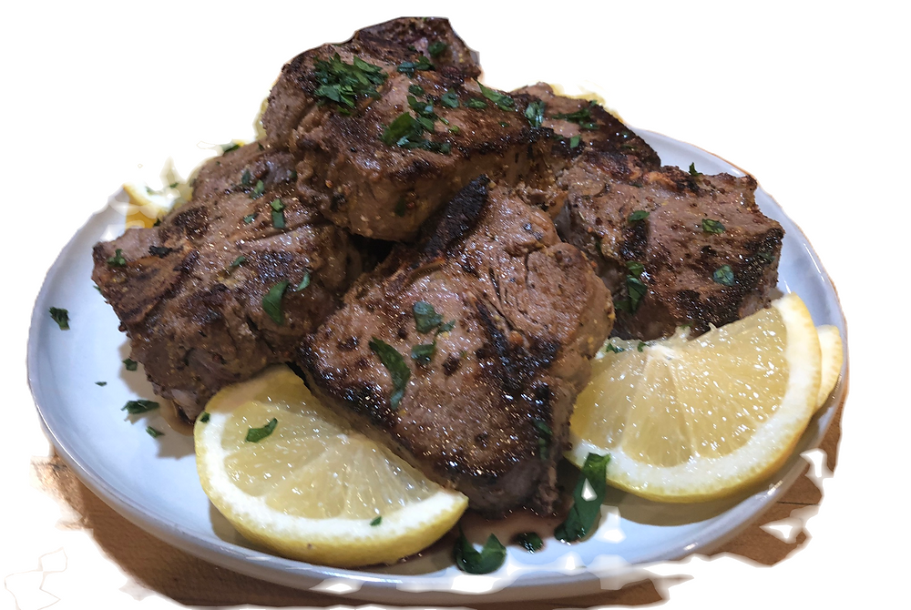 Lamb chops with lemon , herbs, and mustard.