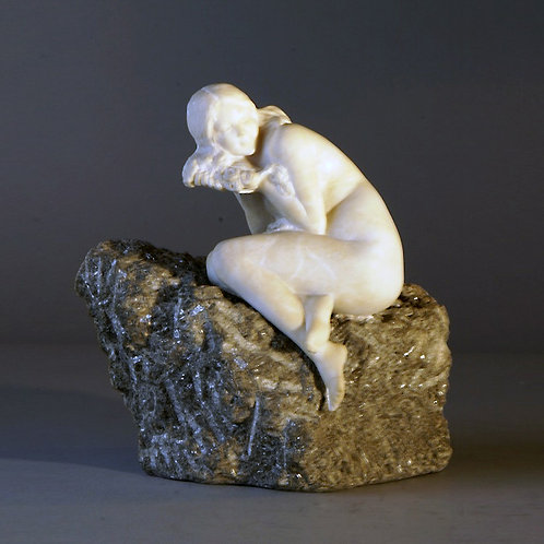 Marble Woman Resting on Rock