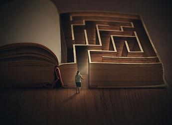 A woman enters into a book maze..jpg