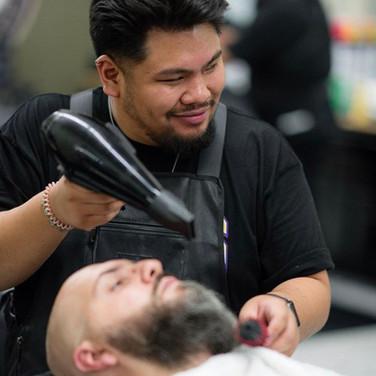Barber Smiling Cutting hair