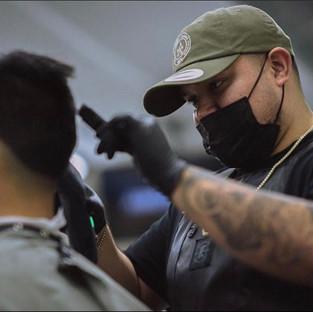 David the Barber cutting hair