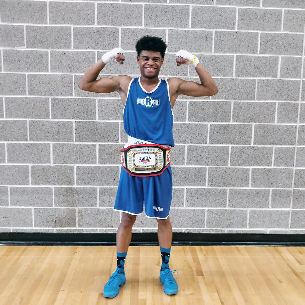 Tyler Matthews from The Bloc with his belt after winning the 2018 United States Intercollegiate Boxing Championship