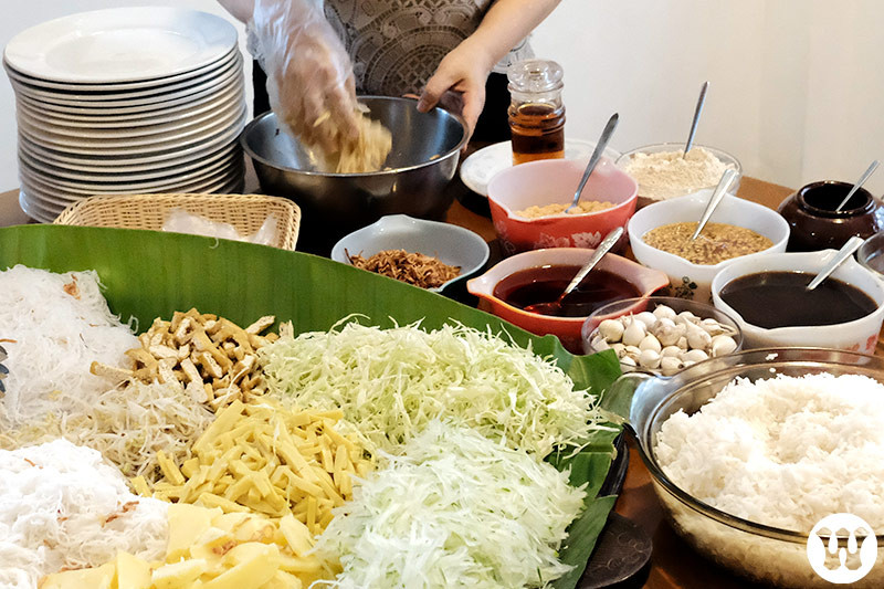 Mixing the various ingredients with hands the Myanmar way