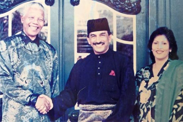 Fond memory: Mandela (left) had a special admiration for Malaysia, says Abdul Kadir, seen here with his late wife Dr Sara Ibrahim. He is now married to Tengku Rasilah.