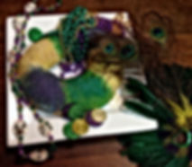 King cake and mardi gras decorations