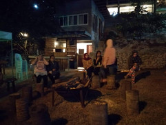 IAM faculty members enjoying a social  Bon-fire event after a day of professional development and Training