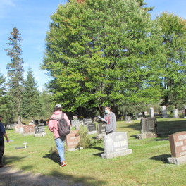 10. Students placing crosses on the graves at Evergreen Cemetery.jpg