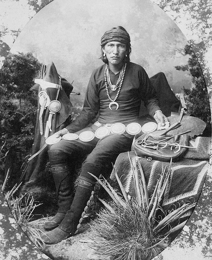 Navajo_silversmith_with_examples_of_his_work_and_tools,_1880_-_NARA_-_518913.jpg