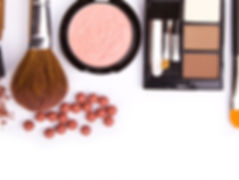 makeup brush and cosmetics, on a white b