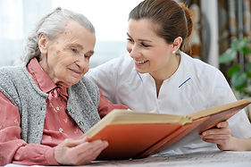 Dove nurse reading to elderly woman, respite care