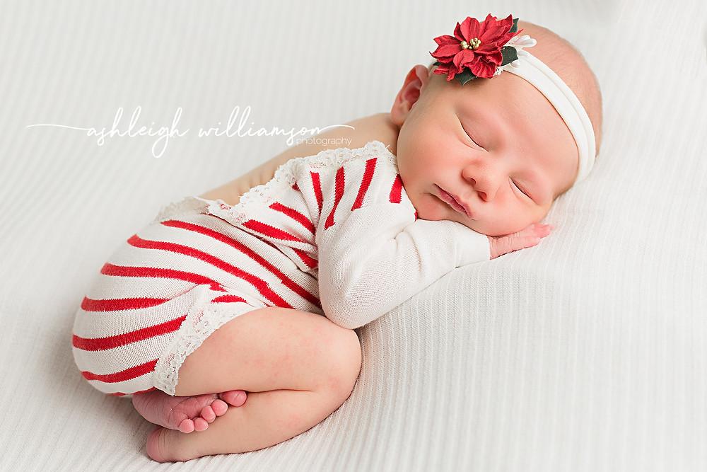 newborn baby girl with poinsettia headband