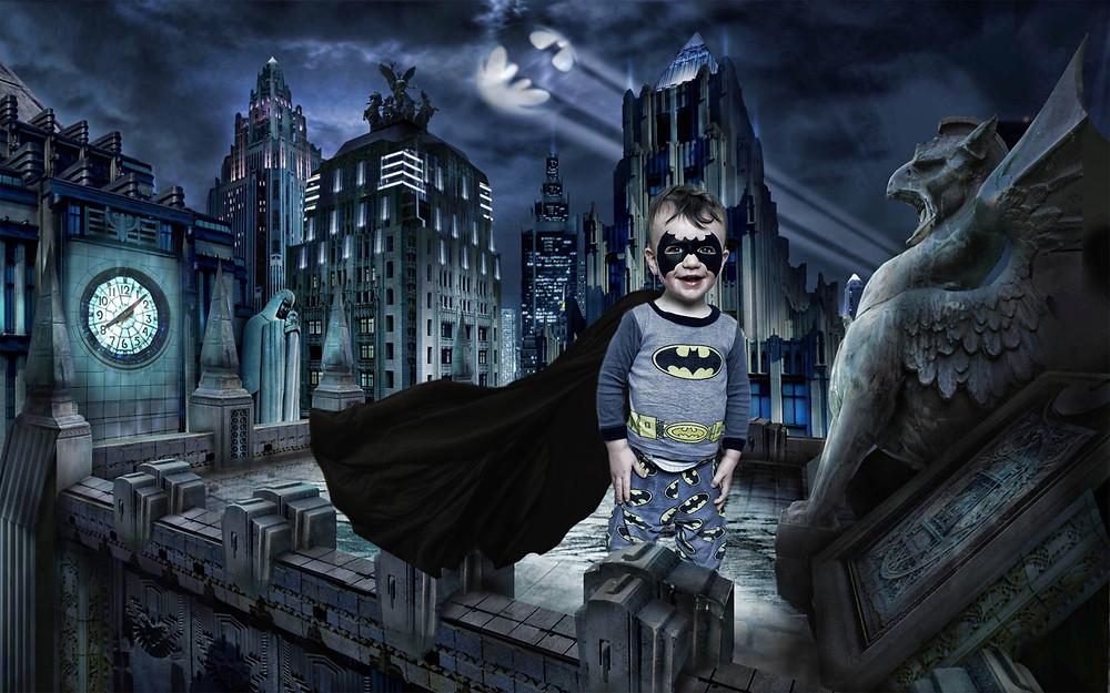 toddler in batman pajamas in gotham city