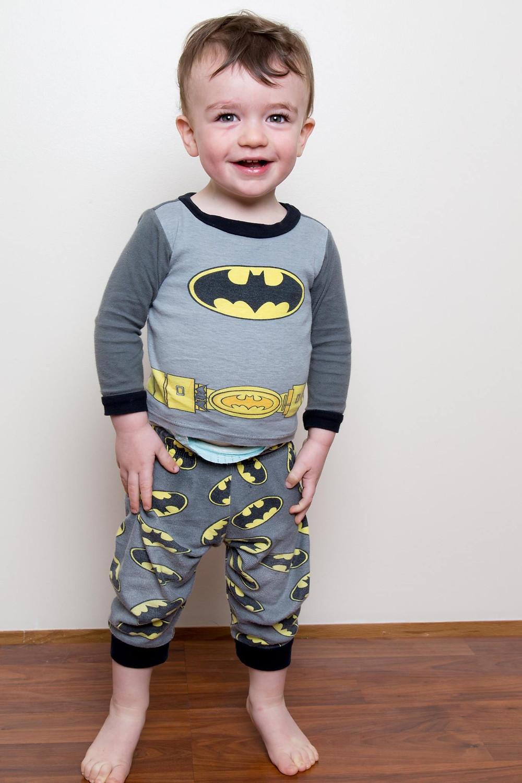 toddler in batman pajamas
