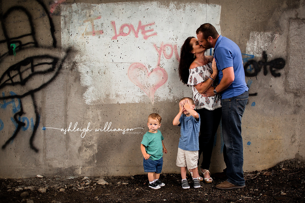 family photo parents kissing