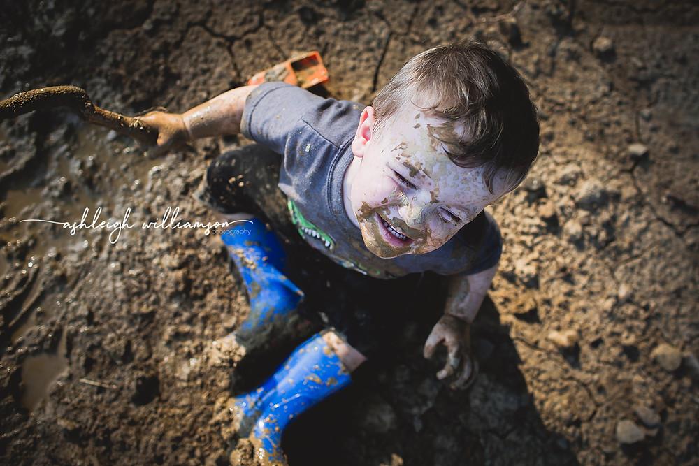 toddler in mud