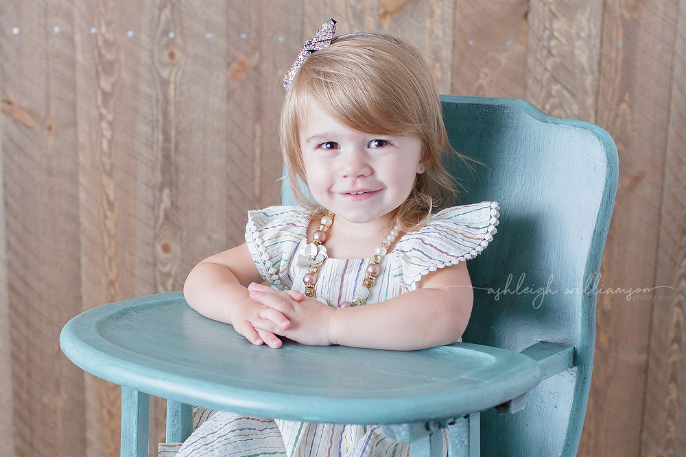 toddler in a high chair
