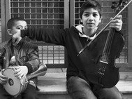 Young boys playing instruments.jpeg