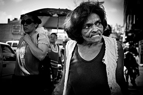 Old Woman Walking In Harlem, New York. A