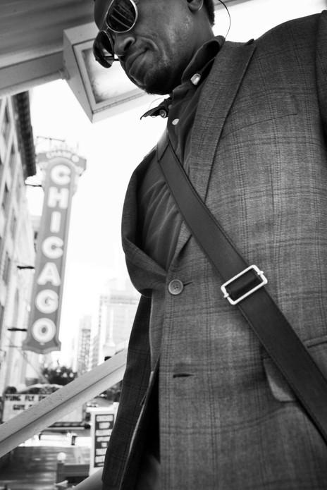 man walking down stairs, Chicago. June 6, 2014.jpg
