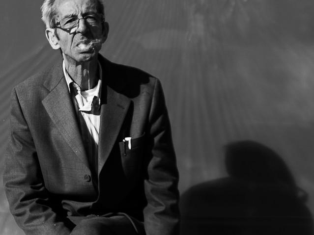 Old man smoking, Barcelona. November 18,