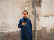 Man on Addidas phone, August 5, 2018.jpe
