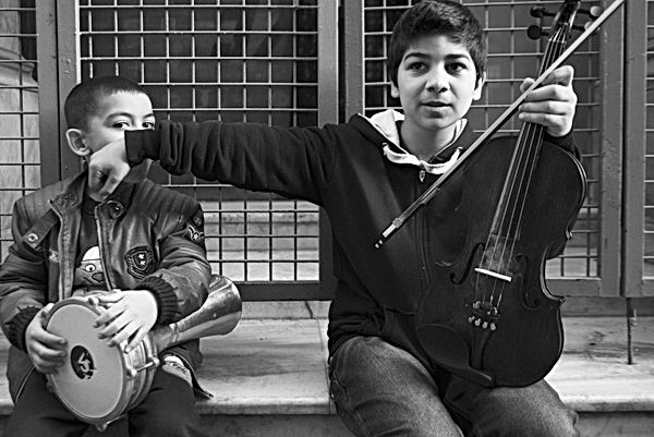 Young boys playing instruments.jpg