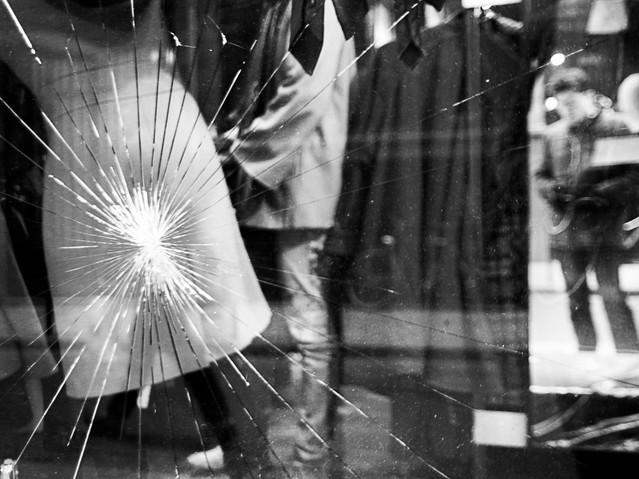 Customer shot through a window, Paris. N