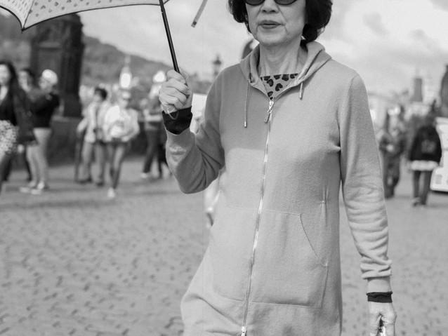 Asian WOman Umbrella, Prague. August 27,